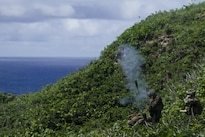 Marines fire an 81 mm mortar from the side of a mountain during training at Farallon de Medinilla Range, Northern Mariana Islands, Sept. 16, 2016. Marine Corps photo by Staff Sgt. T.T. Parish