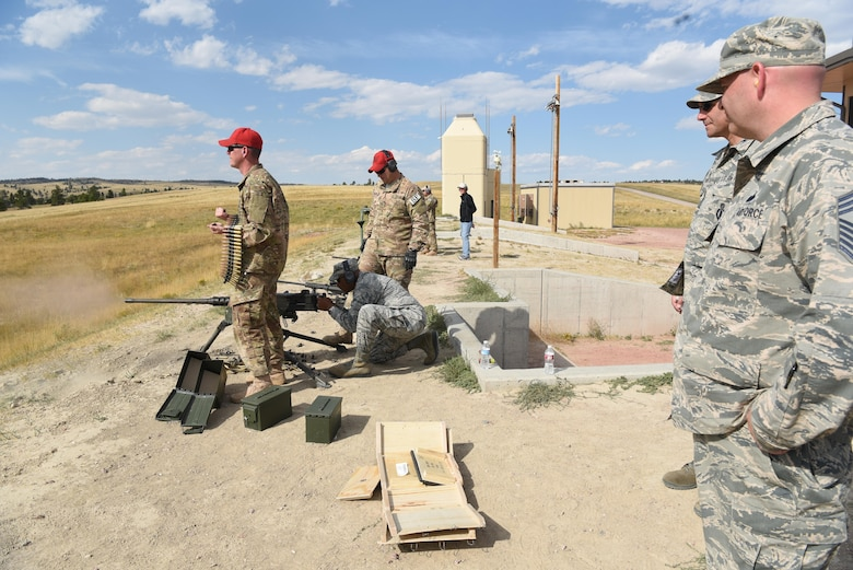Maj. Gen. Anthony Cotton, 20th Air Force and Task Force 214 commander, fires a .50-caliber M2 heavy-barrel machine gun during the fall 20th AF Senior Leadership Conference at Camp Guernsey, Wyo., Sept. 19, 2016. By testing weapons, 20th AF leaders gained insight into 620th Ground Combat Training Squadron operations. The conference gave 20th AF leadership an opportunity to work together to continually improve mission performance.