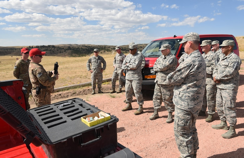 Maj. Gen. Anthony Cotton and his leadership team receive a weapons brief from the 620th Ground Combat Training Squadron combat-arms instructors during the fall 20th Air Force Senior Leadership Conference at Camp Guernsey, Wyo., Sept. 19, 2016. The wing commanders and command chiefs from the four wings tested weapons used by security forces Airmen. The conference gave 20th AF leadership an opportunity to work together to continually improve mission performance.
