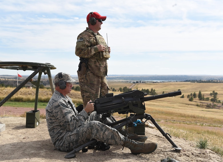 Col. Colin Connor, 91st Missile Wing commander, fires an MK-19 automatic grenade launcher during the fall 20th Air Force Senior Leadership Conference at Camp Guernsey, Wyo., Sept. 19, 2016. 20th AF wing commanders and command chiefs took turns testing the weapons used by security forces Airmen. The conference gave 20th AF leadership an opportunity to work together to continually improve mission performance.