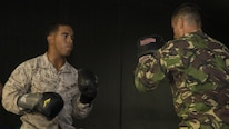 U.S. Marines and Romanian soldiers spar during a martial arts instructor course at Mihail Kogălniceanu Air Base, Romania, Sept. 21, 2016. The Black Sea Rotational Force is an annual multilateral security cooperation deployment in the Black Sea, Balkan and Caucasus regions designed to enhance participants' collective professional military capacity, promote regional stability and build enduring relationships with partner nations.