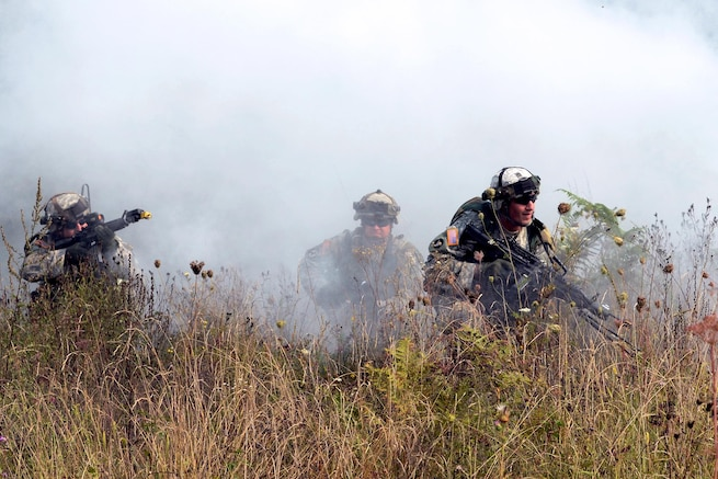 U.S. soldiers conduct an attack drill through smoke as part of Immediate Response 16 at the armed forces training area in Slunj, Croatia, Sept. 14, 2016. The brigade-level exercise uses computer-assisted simulations to train Army National Guardsmen in Croatia and Slovenia. Army photo by Staff Sgt. Opal Vaughn