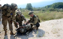 U.S. soldiers prepare to move a simulated casualty during a deliberate attack drill as part of exercise Immediate Response 16 at the armed forces training area in Slunj, Croatia, Sept. 14, 2016. The soldiers are combat medics assigned to Company C, 173rd Brigade Support Battalion. Army photo by Staff Sgt. Opal Vaughn