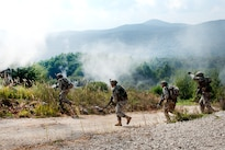 U.S. soldiers cross a road under the cover of smoke to assault an objective during a deliberate attack drill as part of exercise Immediate Response 16 at the armed forces training area in Slunj, Croatia, Sept. 14, 2016. Army photo by Staff Sgt. Opal Vaughn