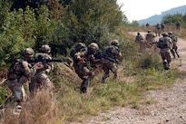 Montenegrin soldiers assault an objective during a deliberate attack drill as part of exercise Immediate Response 16 at the armed forces training area in Slunj, Croatia, Sept. 14, 2016. Army photo by Staff Sgt. Opal Vaughn
