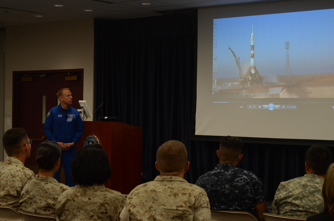 NASA astronaut Timothy Kopra presented his unique experience aboard Expedition 47 at the Defense Information School on Fort Meade, Md., Sept. 13, 2016. Students from a variety of military branches listened intently to his video feature.