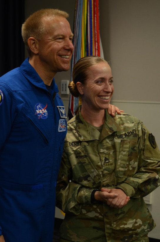 NASA astronaut Timothy Kopra (left) and Defense Information School Public Affairs instructor Staff Sgt. Heather Denby (right) smile for the camera following his presentation at DINFOS, Fort Meade, Md., Sept. 13, 2016. Kopra's visit enlightened students and staff about his experience aboard Expedition 47.