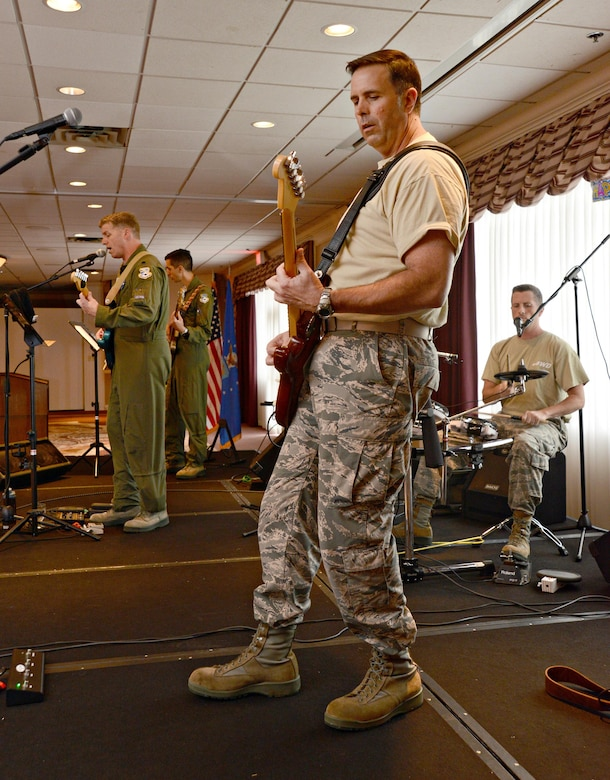 America's Wing Band, a band comprised of active duty officers from the 552nd Air Control Wing, entertained the crowd at the Tinker Club Sept. 15 to help celebrate the Air Force's 69th birthday. (Air Force photo by Kelly White)