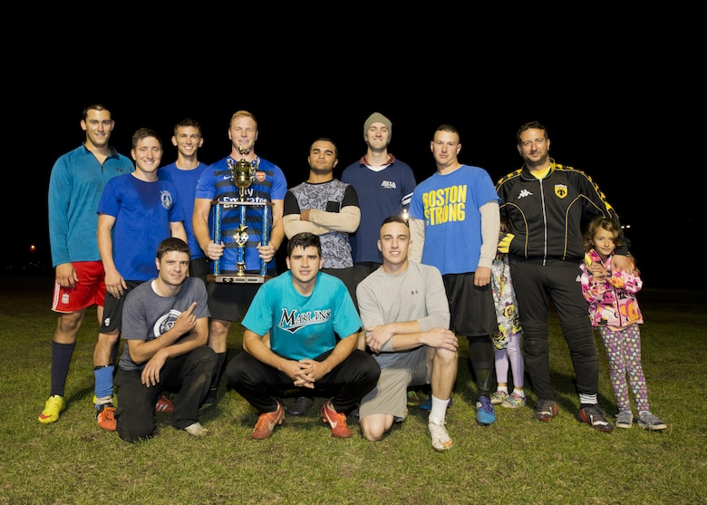 Members of the 5th Maintenance Squadron pose for a photo after the final game of the intramural soccer championship at Minot Air Force Base, N.D., Sept. 21, 2016. The 5th MXS was awarded the trophy after beating the 91st Missile Security Forces Squadron in the final game. (U.S. Air Force photo/Airman 1st Class J.T. Armstrong)