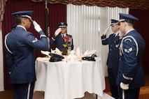 Members of the Tinker Honor Guard perform the POW/MIA Ceremony during the Sept. 9 breakfast. The ceremony is steeped in significance, with every item from the table to the rose, being symbolic of the sacrifices of those who were captured or of those who never returned home.  (Air Force photo by Kelly White)