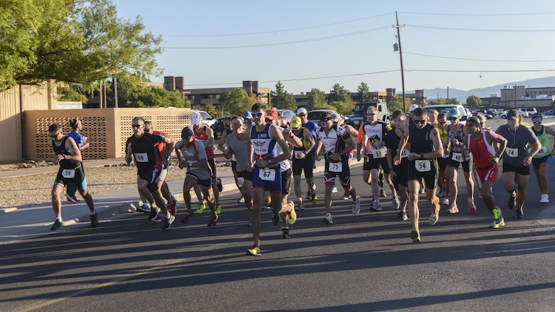 A group of athletes race during Holloman's eighth annual Monster Triathlon at Holloman Air Force Base, N.M. on Sept. 17, 2016. Holloman's first Monster Triathlon was held in 2009. (U.S. Air Force photo by Airman 1st Class Alexis P. Docherty)