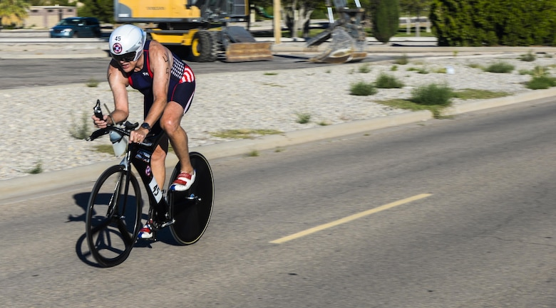 A cyclist swiftly rounds a corner during Holloman's eighth annual Monster Triathlon at Holloman Air Force Base, N.M. on Sept. 17, 2016. Many race participants wore a hydrodynamic form of exercise attire called speedsuits. (U.S. Air Force photo by Airman 1st Class Alexis P. Docherty)