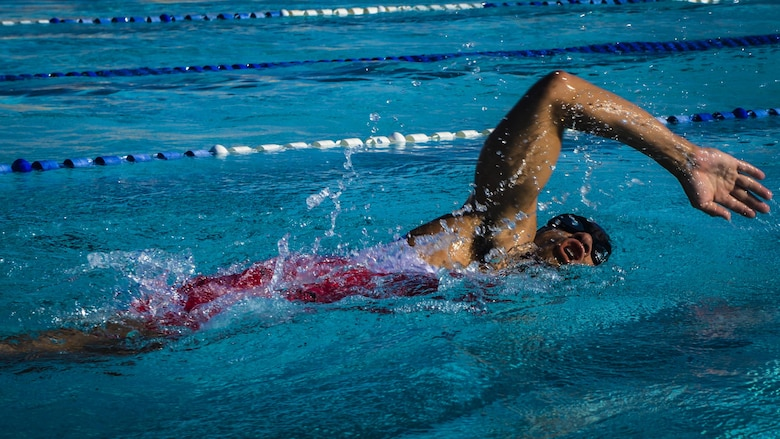 An athlete slices through Holloman's Olympic-sized recreational pool during Holloman's eighth annual Monster Triathlon at Holloman Air Force Base, N.M. on Sept. 17, 2016. Holloman's triathlon is a three-part athletic competition that includes a 5 km run, a 30 km bike race and a 700 meter swim. (U.S. Air Force photo by Airman 1st Class Alexis P. Docherty)