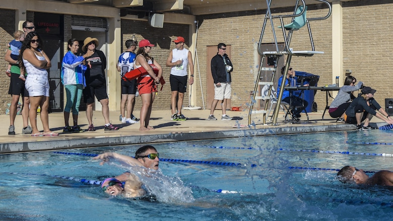 Athletes compete in the 700 meter swimming portion of Holloman's eighth annual Monster Triathlon at Holloman Air Force Base, N.M. on Sept. 17, 2016. Light refreshments and snacks were provided to race participants by 49th Force Support Squadron event staff. (U.S. Air Force photo by Airman 1st Class Alexis P. Docherty)