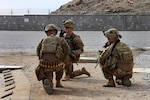 Three soldiers from the 3rd Brigade Combat Team, 101st Airborne Division (Air Assault), assigned to the Train, Advise, Assist Command - East security force, hold their positions and prepare for the landing of a UH-60 Black Hawk helicopter at the conclusion of an advising visit to the Nangarhar police Regional Logistics Center, Afghanistan, Feb. 17, 2015. Army photo by Capt. Jarrod Morris