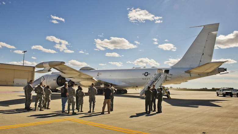 Members of Team Minot look at a U.S. Navy E6-B Mercury during a tour at Minot Air Force Base, N.D., Sept 19, 2016. U.S. Strategic Command's E6-B serves two purposes: a communication relay to submarines and an airborne command post. (U.S. Air Force photo/Airman 1st Class J.T. Armstrong)