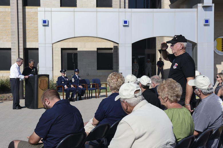 A 6994th Security Squadron 50th anniversary attendee stands for his fallen comrades at the Norma Brown building on Goodfellow Air Force Base, Sept. 22, 2016. The anniversary paid tribute to the 36 Americans that died during the 6994th missions. (U.S. Air Force photo by Airman 1st Class Chase Sousa/Released)