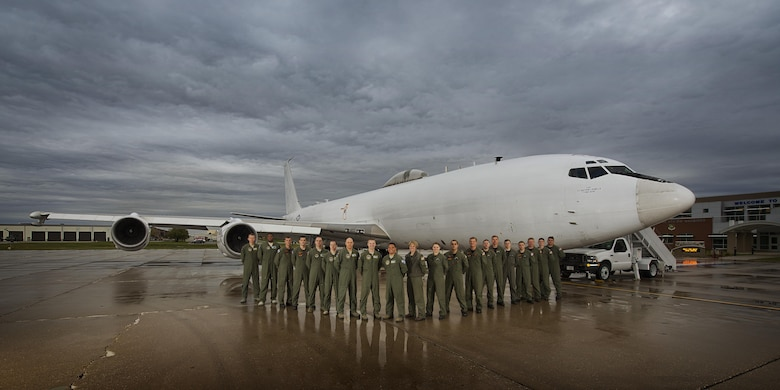 Members of U.S. Strategic Command stand in front of their U.S. Navy E6-B Mercury at Minot Air Force Base, N.D., Sept 19, 2016. The crew operates as the Airborne Command Post, having the ability to command and control U.S. STRATCOM's Intercontinental Ballistic Missiles. (U.S. Air Force photo/Airman 1st Class J.T. Armstrong)