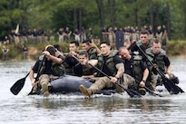 Paratroopers compete in the Waal River Crossing Competition at Fort Bragg, N.C., Sept. 22, 2016. The event marks the 72nd anniversary of when engineers assisted the 504th Parachute Infantry Regiment across the Waal River under enemy fire. Soldiers used only helmets and rifles as paddles in canvass boats. Army photo by Sgt. Anthony Hewitt