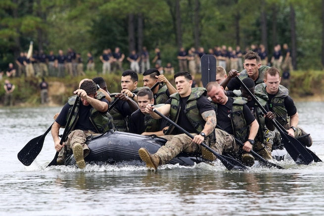 Paratroopers paddle in the Waal River Crossing Competition at Fort Bragg, N.C., Sept. 22, 2016. The event marks the 72nd anniversary of enginners who assisted the 504th Parachute Infantry Regiment across the Waal River under enemy fire. Soldiers used only helmets and rifles as paddles. Army photo by Sgt. Anthony Hewitt