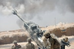 Soldiers with Battery C, 1st Battalion, 320th Field Artillery Regiment, Task Force Strike, execute a fire mission with an M777 howitzer during an operation to support Iraqi security forces at Kara Soar Base, Iraq, Aug. 7, 2016. Army photo by 1st Lt. Daniel I Johnson