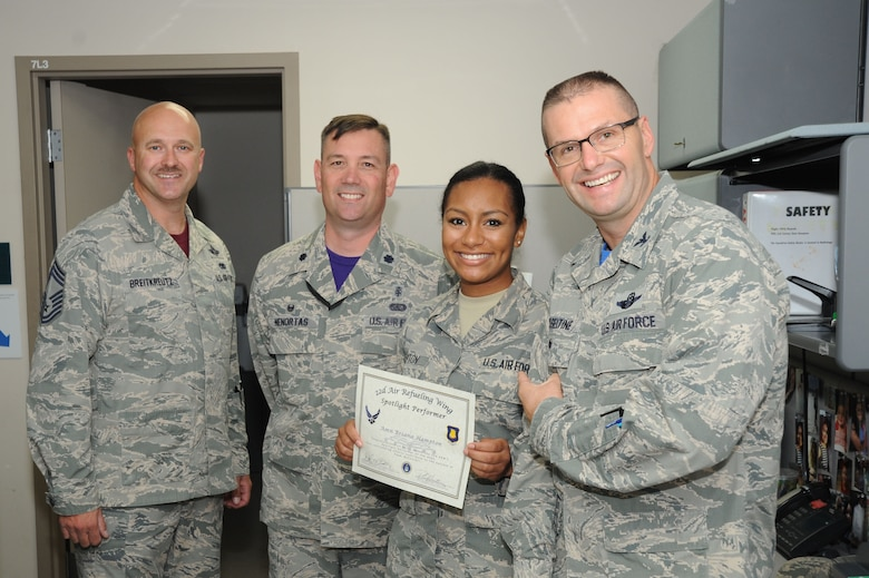 Airman Briana Hampton, 22nd Medical Support Squadron medical records technician, poses with Col. Phil Heseltine, 22nd Air Refueling Wing vice commander, Lt. Col. Lee Nenortas, 22nd Medical Support Squadron commander and Chief Master Sgt. Donald Breitkreutz, 22nd Operations Group superintendent, Sept. 23, 2016, at McConnell Air Force Base, Kan. Hampton received the spotlight performer for the week of Aug. 29 - Sept. 2. (U.S. Air Force photo/Airman 1st Class Jenna K. Caldwell)
