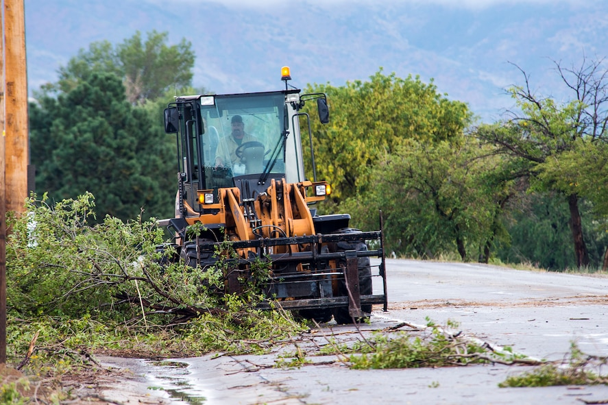 Debris is removed from a roadway on Hill Air Force Base, Utah, following a storm during the afternoon commute. The storm resulted in power outages, traffic delays, and damage across the base. (U.S. Air Force photo by Paul Holcomb)