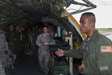 U.S. Air Force Tech Sgt. Erickson Cristobal, 18th Aeromedical Evacuation Squadron aeromedical technician, explains his role in the aeromedical mission to students attending the Joint Professional Military Education Okinawa Experience Sept. 21, 2016, at Kadena Air Base, Japan. The Joint PME gives enlisted leaders the opportunity to get a better grasp of other service's mission and role in the Pacific.