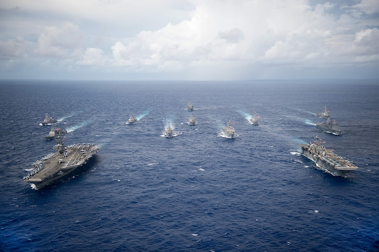 PHILIPPINE SEA -- USS Ronald Reagan (CVN 76) and USS Bonhomme Richard (LHD 6) lead a formation of Carrier Strike Group Five and Expeditionary Strike Group Seven ships including, USS Momsen (DDG 92), USS Chancellorsville (CG 62), USS Stethem (DDG 63), USS Benfold (DDG 65), USS Curtis Wilbur (DDG 54), USS Germantown (LSD 42), USS Barry (DDG 52), USS Green Bay (LPD 20), USS McCampbell (DDG 85), as wells as USNS Walter S. Diehl (T-AO 193) during a photo exercise to signify the completion of Valiant Shield 2016. Valiant Shield is a biennial, U.S. only, field-training exercise with a focus on integration of joint training among U.S. forces. This is the sixth exercise in the Valiant Shield series that began in 2006.