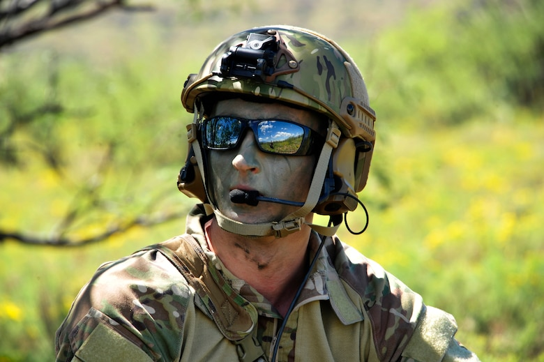 U.S. Air Force 1st Lt. Jaron Jablonski, 55th Rescue Squadron HH-60G Pave Hawk co-pilot, waits in concealment for rescue assets to arrive during a search and rescue exercise at Outlaw/Jackal military operations area in southeastern Ariz., Sept. 15, 2016. During the exercise Jablonski played as the survivor whose goal was to use tools he learned during survival, evasion, resistance and escape to evade the simulated enemy until rescue assets arrived. (U.S. Air Force photo by Senior Airman Cheyenne A. Powers)