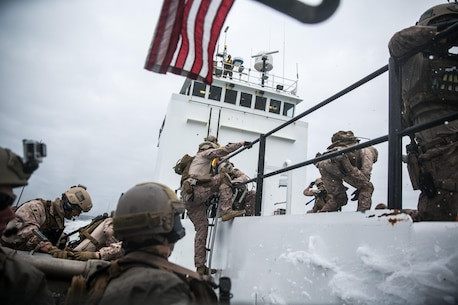 AT SEA, Pacific Ocean (September 12, 2016) - Marines with Maritime Raid Force, 11th Marine Expeditionary Unit board a simulated enemy vessel during a Visit, Board, Search, and Seizure mission conducted off the coast of San Clemente Island, California, as part of the MEU's Certification Exercise, Sept. 12, 2016. CERTEX is the final exercise in the MEU's pre-deployment training cycle, in which they are evaluated in amphibious operation mission sets prior to their upcoming deployment. (US Marine Corps photo by Lance Cpl. Devan K. Gowans/Released)