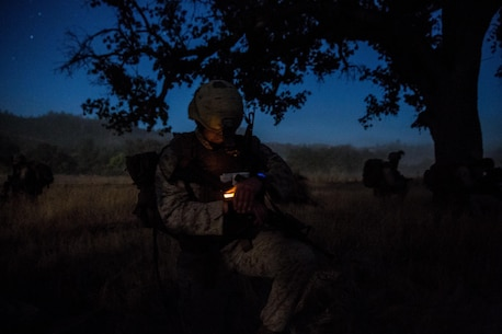 "FORT HUNTER LIGGETT, California (September 16, 2016) – A Marine with Battalion Landing Team, 1st Bn., 4th Marines, 11th Marine Expeditionary Unit, finds his bearing following a helicopter insertion into Fort Hunter Liggett, California, prior to conducting a raid held during the 11th MEU's Certification Exercise, September 16, 2016. As part of the long-range raid, the BLT launched from the USS Makin Island (LHD 8) off the coast of Southern California and flew more than 225 miles to the objective area. The Marines conducted a 10-mile night movement to position themselves for the assault on the enemy forces, clearing the twon of any ""role playing"" militants (U.S. Marine Corps photo by Lance Cpl. Devan K. Gowans/Released)"