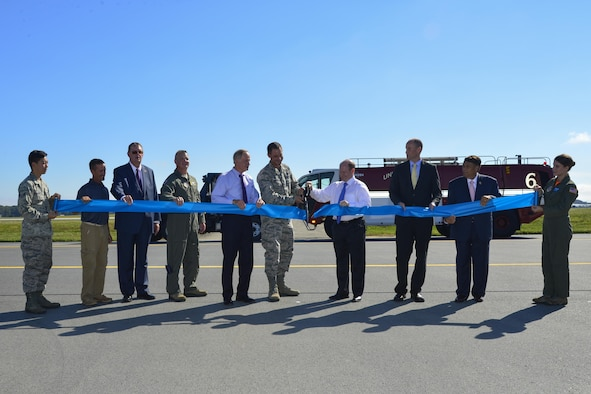 Col. Ethan Griffin, 436th Airlift Wing commander, and Sen. Chris Coons, D-Del.; cut a ribbon marking the reopening Runway 01-19 during an extensive reconstruction project Sept. 23, 2016, at Dover Air Force Base, Del. Shown from left, Airman 1st Class Joseph Cho, 436th Aircraft Maintenance Squadron; Tony Price, sub-contractor representative; Jeff Wagonhurst, Versar Inc. president and CEO; Col. Scott Durham, 512th AW commander; Sen. Tom Carper, D-Del.; Col. Ethan Griffin, 436th AW commander; Sen. Chris Coons, D-Del.; Drew Slater, Rep. John Carney D-Del. representative; Robin Christiansen, Mayor of Dover; and Airman 1st Class Paula Padilla, 9th Airlift Squadron loadmaster. (U.S. Air Force photo by Senior Airman William Johnson)