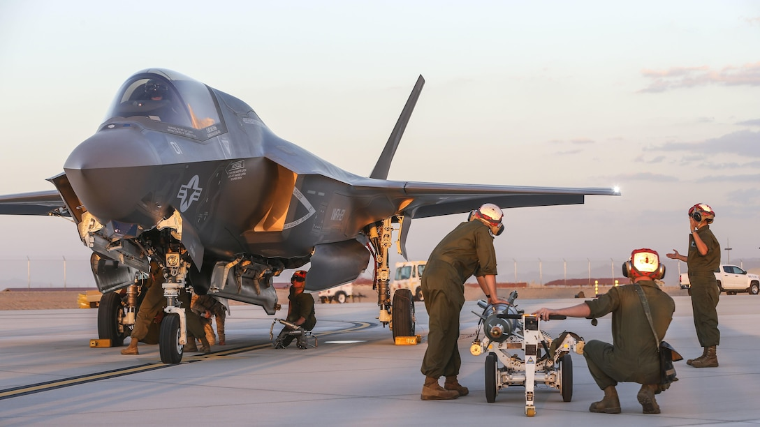 U.S. Marines with Marine Fighter Attack Squadron 121, 3rd Marine Aircraft Wing, conduct the first ever hot load on the F-35B Lightning II in support of Weapons and Tactics Instructor Course 1-17 at Marine Corps Air Station Yuma, Ariz., Sept. 22, 2016. The exercise is part of WTI 1-17, a seven-week training event hosted by Marine Aviation Weapons and Tactics Squadron One cadre. MAWTS-1 provides standardized tactical training and certification of unit instructor qualifications to support Marine Aviation Training and Readiness and assists in developing and employing aviation weapons and tactics.
