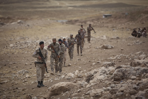 Soldiers from the Nineveh Plain Protection Unit patrol a mountainside during a react to contact training exercise at their training facility in the Nineveh Province, May 18, 2016.  The NPPU are a small group of fighters who came together to protect their people in the fight against the Islamic State of Iraq and the Levant.  Training focused on the Combined Joint Task Force – Operation Inherent Resolve overall mission to build partner capacity and increase the military capacity of local forces fighting ISIL.  (U.S. Army photo by Staff Sgt. Sergio Rangel)