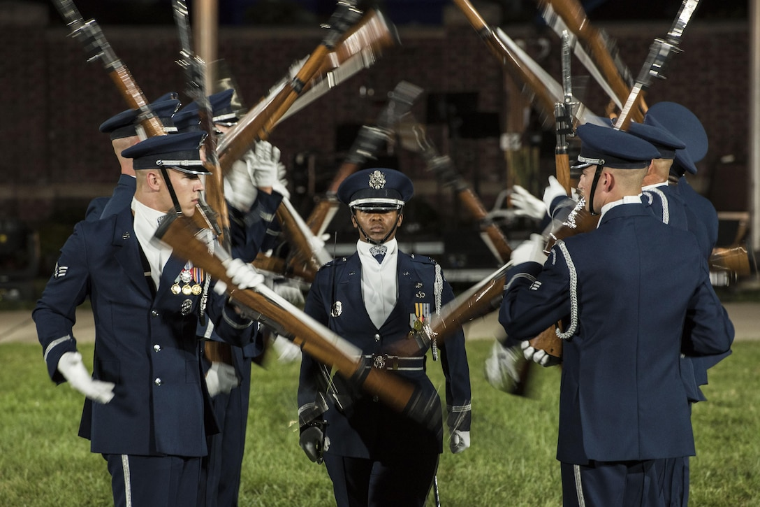 The U.S. Air Force Honor Guard Drill Team performs a rifle demonstration during the 2016 Air Force Tattoo at Joint Base Anacostia-Bolling in Washington, D.C., Sept. 22, 2016. The event commemorated the Air Force's 69th birthday. Air Force photo by Senior Airman Jordyn Fetter