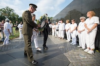 Marine Corps Gen. Joe Dunford, chairman of the Joint Chiefs of Staff; Candy Martin, national president of American Gold Star Mothers Inc.; and Jim Knotts, Vietnam Veterans Memorial Fund president and CEO, place a wreath at the memorial in Washington, D.C., Sept. 24, 2016. DoD photo by Army Sgt. James McCann