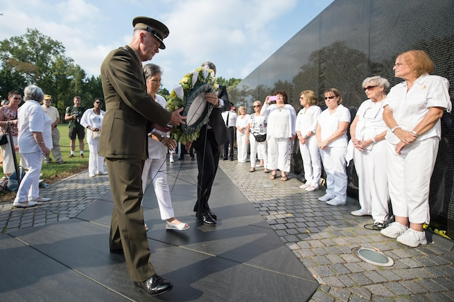 Marine Corps Gen. Joe Dunford, chairman of the Joint Chiefs of Staff; Candy Martin, national president of American Gold Star Mothers Inc.; and Jim Knotts, president and CEO of the Vietnam Veterans Memorial Fund, place a wreath at the memorial in Washington, D.C., Sept. 24, 2016. DoD photo by Army Sgt. James McCann