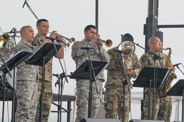 U.S. Army members of the 8th Army Band perform during Air Power Day 2016 at Osan Air Base, Republic of Korea, Sept. 25, 2016. The 8th Army Band performs across the peninsula to provide morale and community integration with military members. (U.S. Air Force photo by Senior Airman Dillian Bamman)
