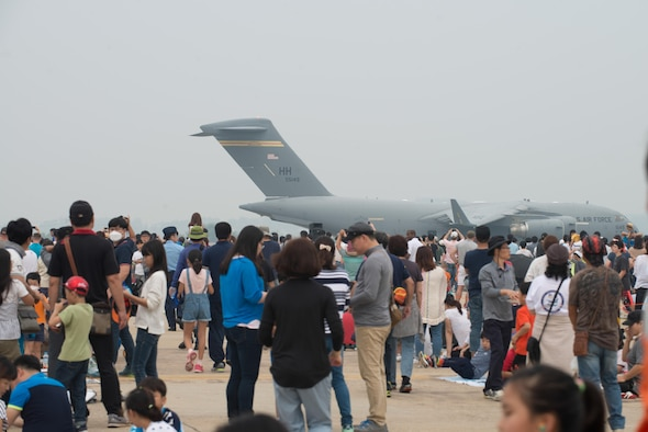 Air show attendees watch as a C-17 Globemaster III taxis in reverse after landing during Air Power Day 2016 at Osan Air Base, Republic of Korea. The C-17 has the capability to deploy personnel and cargo to locations across the world. (U.S. Air Force photo by Senior Airman Dillian Bamman)