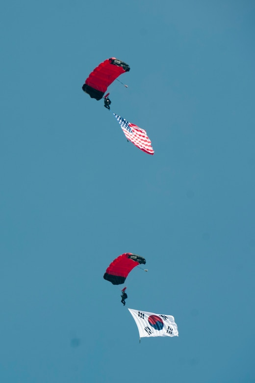 U.S. and Republic of Korea flags sail through the sky attached to a Republic of Korea Parachute Demonstration Team parachutist during Air Power Day 2016 on Osan Air Base, Republic of Korea, Sept. 24, 2016. Air Power Day was a chance for U.S. and Korean attendees to get to know one another while watching aerial demonstrations, entertainment and more. (U.S. Air Force photo by Staff Sgt. Jonathan Steffen)