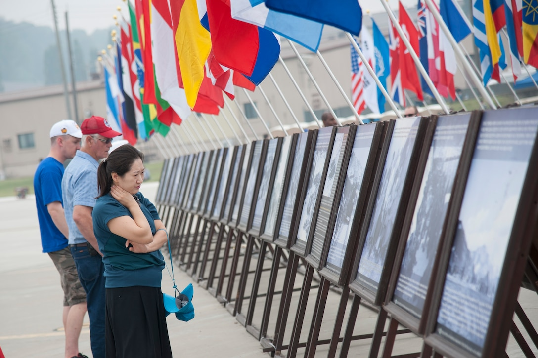 Crowds looks at the Korean War memorial photos exhibit at Air Power Day 2016 on Osan Air Base, Republic of Korea, Sept 25, 2016. Air Power Day had a variety of static displays including aircrafts, weapons load, and booths featuring units throughout Osan. (U.S. Air Force photo by Staff Sgt. Jonathan Steffen)