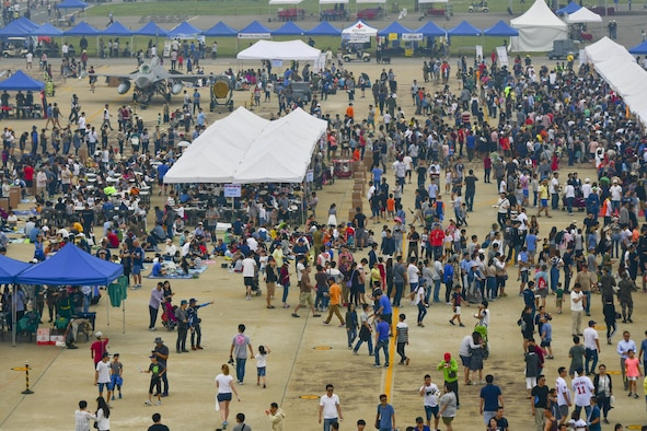 Tens of thousands of people attend Air Power Day 2016 at Osan Air Base, Republic of Korea, Sept. 25, 2016. The air show, which is the first in four years, featured aerial performances from American and ROK acts, music performances from bands including Sublime with Rome, and dozens of food and memorabilia vendors. (U.S. Air Force photo by Senior Airman Victor J. Caputo)