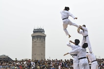 Members of the Republic of Korea Martial Arts Demonstration Team perform orchestrated movements during Air Power Day 2016 at Osan Air Base, Republic of Korea, Sept. 25, 2016. Members of Team Osan and the surrounding community participated in events for the air show such as static displays, aircraft takeoffs and aerial demonstrations. (U.S. Air Force photo by Tech. Sgt. Rasheen Douglas)