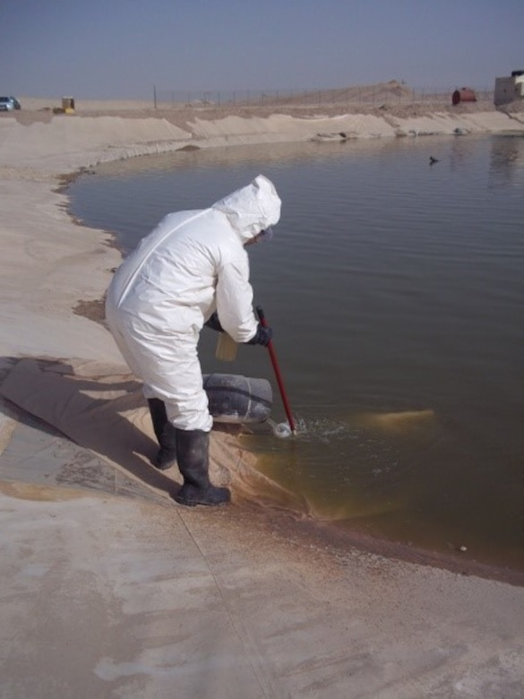 A U.S. Army Central environmental waste employee checks the condition of a wastewater lagoon operation and management facility at Camp Beuhring, Kuwait. A lack of environmental protection, long-running conflicts, natural conditions and industrialization issues prove to be daunting challenges that the military is constantly working to overcome. ARCENT's goal is to appropriately manage available resources while maximizing operational capability, resource availability and well-being. This includes initiating actions to limit damage to the environment caused during full spectrum operations wherever and whenever possible.