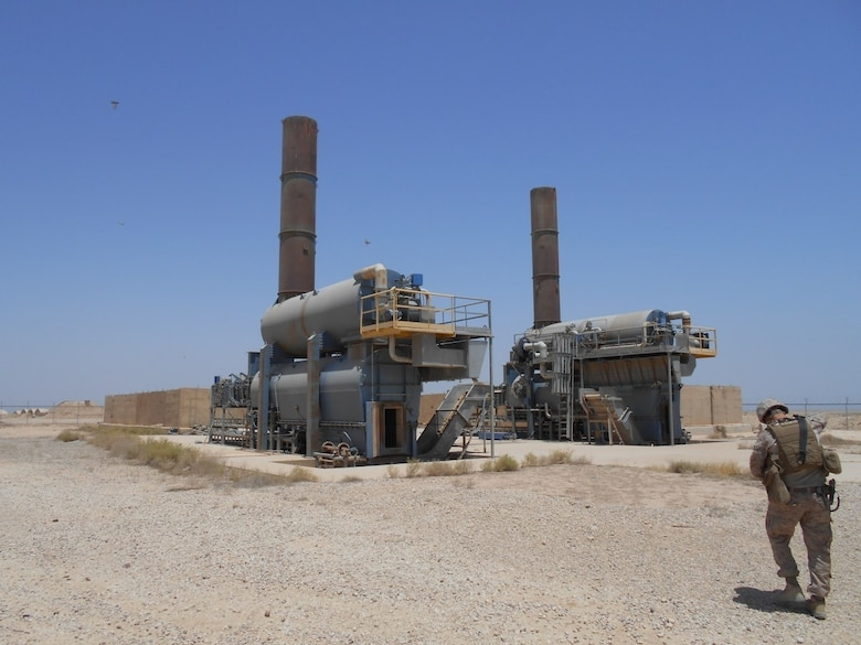 A Marine inspects incinerators at Camp Al Taqaddum, Iraq.  Incinerators have been implemented throughout the U.S. Army Central area of operations as a more eco-friendly solution to disposing of waste. U.S. forces are readily deployable to anywhere on the planet and have the capability to set up operations under very harsh conditions to meet the required objectives. A set of environmental guidelines is followed to minimize initial impact and alternatives that are more protective of human health and the environment are constantly implemented as operations transition from initial deployment into sustainment.