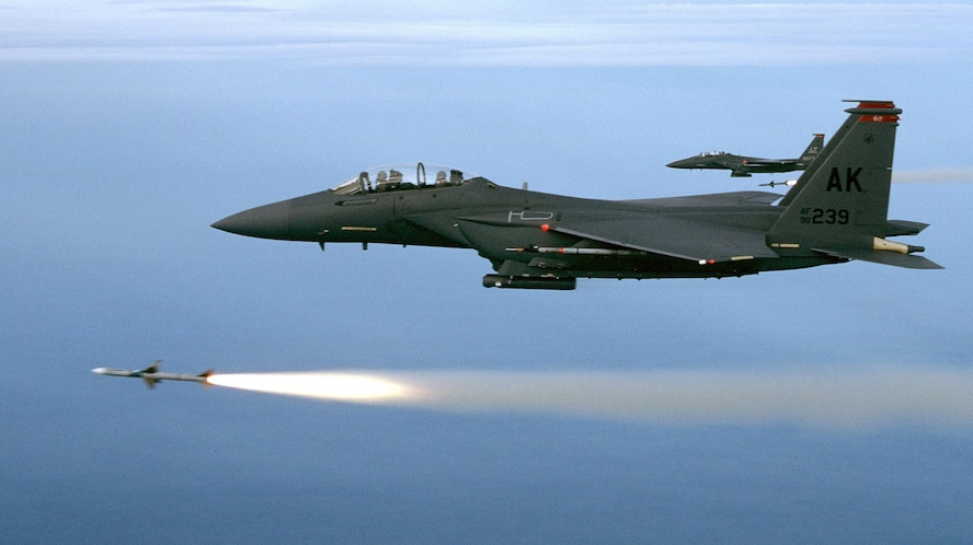 Two F-15E aircraft assigned to the 90th Fighter Squadron, Elmendorf Air Force Base, Alaska, fire AIM-7M's during a training mission over the Gulf of Mexico. (U.S. Air Force Photo)