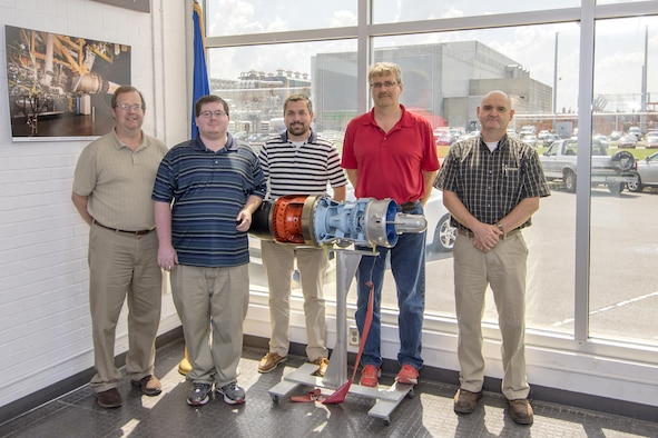A group of AEDC software engineers, pictured here, recently assisted in improving the Computer Assisted Dynamic Data Monitoring and Analysis System and Propulsion Data Processing and Analysis System to benefit operations of future turbine test projects. Some of the engineers involved in this effort were, left to right, Stephen Powell, Michael Walker, Nathan Harrison, Rusty Zarecor and Phil Voyles.