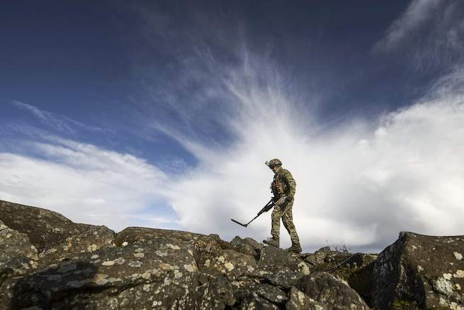 Air Force Staff Sgt. Cole Carroll sweeps an area with a mine detector during Northern Challenge 16 at Icelandic Coast Guard Keflavik Facility, Iceland, Sept. 19, 2016. The exercise focused on disabling improvised explosive devices to prepare NATO and Nordic nations. Air Force photo by Staff Sgt. Jonathan Snyder