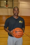 Army Chief Warrant Officer 3 Aaron L. Bryant, a senior petroleum system technician for the 3rd Infantry Division Sustainment Brigade, poses for a photo at Jordan Gym at Fort Stewart, Ga., Sept. 14, 2016. Bryant was the coach for the All-Army Women's Basketball Team and he's currently trying to start a men's post team at Fort Stewart. Army photo by Sgt. Caitlyn C. Smoyer